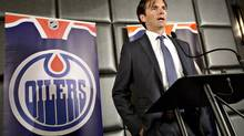 Edmonton Oilers head coach Dallas Eakins speaks during a press conference in Edmonton, Alta., on Monday June 10, 2013. Rocky Thompson joins Eakins' staff along with Craig Ramsay, who was hired earlier this off-season. (JASON FRANSON/THE CANADIAN PRESS)