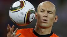 Netherlands' Arjen Robben catches the ball during their 2010 World Cup second round soccer match against Slovakia at Moses Mabhida stadium in Durban June 28, 2010. (CARLOS BARRIA/REUTERS)