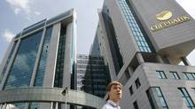 A man passes by the Sberbank headquarters in Moscow in this 2011 file photo. (DENIS SINYAKOV/DENIS SINYAKOV/REUTERS)