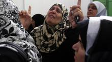 Palestinian relatives of nine members of the al-Dalo family mourn during their funeral in Gaza City Nov. 19, 2012. (AHMED ZAKOT/REUTERS)