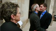 As Rev. Peg Esperanza looks on, Gary Seronko and Curtis Rathmeier celebrate their marriage on the steps of the Polk County Administration Building in Des Moines, Iowa. (Scott Olson/Getty Images/Scott Olson/Getty Images)
