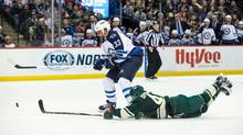 Minnesota Wild defenceman Jared Spurgeon (46) pokes the puck away from Winnipeg Jets defenceman Dustin Byfuglien (33) on a breakaway during the second period at Xcel Energy Center in Saint Paul, MN on Friday, Jan. 15, 2016. (Brace Hemmelgarn/USA Today Sports)