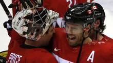 Canada's Shea Weber (R) celebrates with goalie Carey Price after Canada won their men's ice hockey semi-final game against Team USA at the 2014 Sochi Winter Olympic Games, February 21, 2014. (GRIGORY DUKOR/REUTERS)