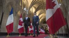 Canadian Prime Minister Justin Trudeau and French Prime Minister Manuel Valls walk through the Hall of Honour on Parliament Hill in Ottawa, Thursday October 13, 2016. (Adrian Wyld/THE CANADIAN PRESS)