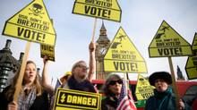 Political activists protest outside the Houses of Parliament as they call for American citizens to cast their votes in next week's U.S. Presidential election, on November 3, 2016 in London, England. (Leon Neal/Getty Images)