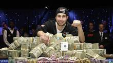 Jonathan Duhamel of Canada poses with prize money and his championship bracelet after beating John Racener of the U.S. in the finals of World Series of Poker Main Event at the Rio hotel-casino in Las Vegas, Nevada November 8, 2010. (STEVE MARCUS/REUTERS/STEVE MARCUS/REUTERS)