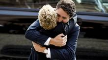 Canada's Prime Minister designate Justin Trudeau hugs Ontario Premier Kathleen Wynne at Queen's Park in Toronto, October 27, 2015. (MARK BLINCH/REUTERS)