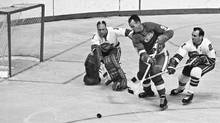 In October, 1967, Gordie Howe, the Detroit Red Wings great, contends with California Seals goalie Charlie Hodge and defenceman Bob Baun. (Preston Stroup/AP)