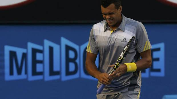 Jo-Wilfried Tsonga of France reacts during his men's singles quarter-final match against Roger Federer of Switzerland at the Australian Open tennis tournament in Melbourne, January 23, 2013. (DAMIR SAGOLJ/REUTERS)