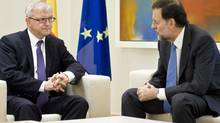 Spain's Prime Minister Mariano Rajoy, right, talks with European Commissioner for Economic and Monetary Affairs Olli Rehn during a meeting at the Moncloa Palace, in Madrid, Oct. 1, 2012. (Daniel Ochoa De Olza/AP)