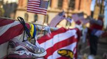 A jogging shoe is seen at a makeshift memorial for the victims of the Boston Marathon bombings on Boylston street in Boston, Massachusetts April 18, 2013. President Barack Obama was due to visit Boston on Thursday to attend a memorial service for victims of the Boston Marathon bombing amid a manhunt for a suspect seen on video taken before two blasts struck near the finish line on Monday. (SHANNON STAPLETON/Reuters)