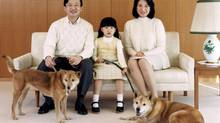 In this photo released by the Imperial Household Agency of Japan, Japanese Crown Prince Naruhito, Crown Princess Masako and their daughter Princess Aiko pose with their pet dogs, Pippi and Mari, at their residence in Togu Palace, Tokyo February 12, 2007. (Reuters)