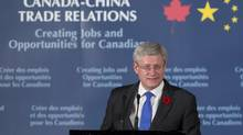 Canadian Prime Minister Stephen Harper speaks to members of the business community in Beijing on Nov. 8. (Adrian Wyld/THE CANADIAN PRESS)