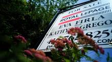 File photo of a sign outside a house for sale in Toronto. (Sami Siva/THE GLOBE AND MAIL)