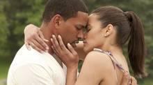 "Laz Alonso and Paula Patton in a scene from ""Jumping the Broom"" (Jonathan Wenk)"