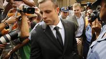 Olympic and Paralympic track star Oscar Pistorius leaves court after the fifth day of his trial for the murder of his girlfriend Reeva Steenkamp at the North Gauteng High Court in Pretoria, March 7, 2014. (MIKE HUTCHINGS/REUTERS)