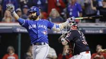 Toronto Blue Jays' Jose Bautista strikes out against the Cleveland Indians during the ninth inning in Game 2 of baseball's American League Championship Series in Cleveland, Saturday, Oct. 15, 2016. (Gene J. Puskar/AP)