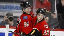 The three Calgary Flames benched for disciplinary reasons have apologized to their teammates, fans and the organization. (Jeff McIntosh/THE CANADIAN PRESS)