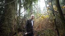 Devon Page, Executive Director at Ecojustice, is photographed while searching for a Douglas fir tree surrounded by various other trees in Stanley Park in Vancouver, British Columbia, Saturday, November 30, 2013. Ecojustice is taking the B.C. government to court over the logging of the last few stands of Coastal Douglas fir. (Rafal Gerszak for The Globe and Mail)