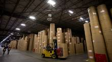 Distribution centres, Catalyst Paper in B.C. pictured, have been busy as forestry exports to China have jumped 'ridiculously.' (DARRYL DYCK For The Globe and Mail)