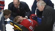 Montreal Canadiens' Lars Eller is taken off the ice following a hit by Ottawa Senators' Eric Gryba (Graham Hughes/The Canadian Press)