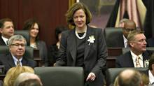 Alberta Premier Alison Redford makes her way to her seat before the Speech from the Throne at the Alberta Legislature in Edmonton on Feb. 7, 2012. (Jason Franson/The Canadian Press)