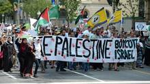 People take part in a protest and march in Ottawa on Tuesday July 22, 2014, calling for Canada to defend human rights in Palestine. (Sean Kilpatrick/THE CANADIAN PRESS)