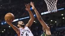 Toronto Raptors guard Cory Joseph (6) drives to the net past Utah Jazz forward Trey Lyles (41) during second half NBA basketball action in Toronto on Wednesday, March 2, 2016. (Nathan Denette/THE CANADIAN PRESS)