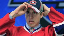 Montreal Canadiens' first pick Jarred Tinordi adjusts his hat during the first round of the 2010 NHL hockey draft in Los Angeles, California June 25, 2010. REUTERS/Mike Blake (MIKE BLAKE)