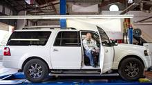 VAUGHAN, ONTARIO: July 31, 2013 - Wendel Clark, 46, former Toronto Maple Leafs captain, poses for a portrait with his 2011 Ford Expedition Max at his Meineke car care centre in Vaughan. ( Photo by Philip Cheung ) (Philip Cheung For The Globe and Mail)