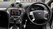 The interior of a driverless car during testing at the headquarters of motor industry research organization MIRA at Nuneaton in the West Midlands, England, Wednesday, July 30, 2014. British officials says driverless cars will be tested on roads in as many as three cities in a trial program to begin in January. Officials said Wednesday the tests will last up to three years. Sensors and cameras will guide the cars. (Rui Vieira/AP)