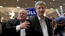 Prime Minister Stephen Harper and Toronto Mayor Rob Ford leave a campaign rally together in Brampton,Ontario on Friday April 29, 2011. (Adrian Wyld/The Canadian Press/Adrian Wyld/The Canadian Press)