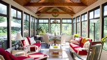 """Interior designer Brenda Bell's home in Blue Mountains, Ont. features a sunroom with a beautiful view. """"It's simply a divine space to feel at one with the beauty of nature,"""" Bell says of the room, """"especially when it's filled with love, laughter and friends."""""""