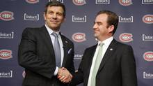 Marc Bergevin, left, shakes hands with Montreal Canadiens president and CEO Geoff Molson after being introduced as the team's new general manager Wednesday. (CHRISTINNE MUSCHI/The Canadian Press)
