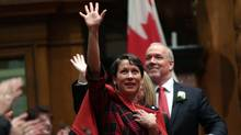 B.C. NDP leader John Horgan with Melanie Mark, MLA for Vancouver-Mount Pleasant, at legislature on Feb. 17. (CHAD HIPOLITO/THE CANADIAN PRESS)