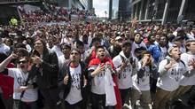 Fans react in Maple Leaf Square as the Toronto Raptors play the Brooklyn Nets during game 7 outside of the Air Canada Centre in Toronto, Sunday May 4, 2014 (Mark Blinch)