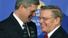 Prime Minister Stephen Harper shares a laugh with Canadian Mental Health Commission chairman Michael Kirby after an Ottawa news conference on Aug. 31, 2007. (CHRIS WATTIE/REUTERS)