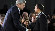 Prime Minister Stephen Harper shakes hands with Shawn Atleo, National Chief of the Assembly of First Nations, during the closing ceremonies of the Crown First Nations Gathering in Ottawa on January 24, 2012. (SEAN KILPATRICK/THE CANADIAN PRESS)