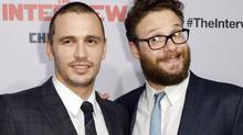"""Cast members James Franco, left, and Seth Rogen pose during premiere of the film """"The Interview"""" in Los Angeles on Dec. 11, 2014. (KEVORK DJANSEZIAN/REUTERS)"""