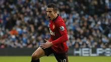 Manchester United's Robin van Persie celebrates after scoring during their English Premier League soccer match against Manchester City at The Etihad Stadium in Manchester, northern England December 9, 2012. (Reuters)