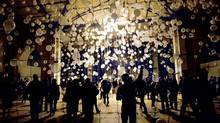 People gather in front of an installation by US artist William Forsythe for the second Nuit Blanche de Paris (PHILIPPE DESMAZES/PHILIPPE DESMAZES)