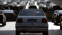 Motorists sit in their cars on a main road during a heavy traffic period in Beijing January 10, 2012. (DAVID GRAY/REUTERS/DAVID GRAY/REUTERS)