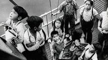 School children stand on the deck of boat near St. Michael's Indian Residential School, Alert Bay, B.C. (National Centre for Truth and Reconciliation Archives)