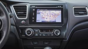 The 2014 Honda Civic Coupe's Display Audio System works well, but there's a learning curve to figure it out.