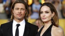 Brad Pitt and Angelina Jolie pose on arrival at the 18th annual Screen Actors Guild Awards in Los Angeles on Jan. 29, 2012. (Mike Blake/Reuters)