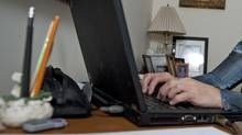 A Toronto bank employee works from home on Oct. 8, 2010. (SARAH DEA/Sarah Dea for The Globe and Mail)