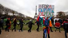 A rally takes place near the Eiffel Tower in Paris on the sidelines of the COP21, the UN conference on global warming, on Dec. 12, 2015. (FRANCOIS GUILLOT/AFP/Getty Images)