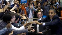 President Barack Obama greets a cheering crowd as he arrives at a campaign event at the Fifth Third Arena on the University of Cincinnati campus, Sunday, Nov. 4. (Carolyn Kaster/AP)