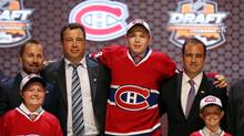 Nikita Scherbak poses for a photo with team officials after being selected as the number twenty-six overall pick to the Montreal Canadiens in the first round of the 2014 NHL Draft at Wells Fargo Center. (Bill Streicher/USA Today Sports)