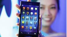 A BlackberryZ3smartphone is shown by a model during its launch in Jakarta, Indonesia, Tuesday, May 13, 2014. (Achmad Ibrahim/AP Photo)